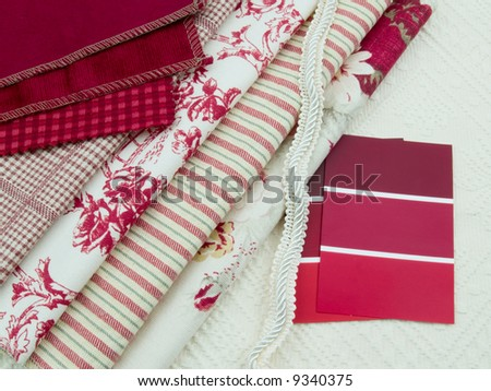 Red and white fabric and paint swatches
