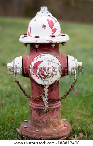 Red and white fire hydrant with peeling paint