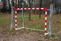 Red and white football forots on a sports ground in a village near Moscow in autumn