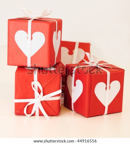 Red and white gift box with white and pink ribbons