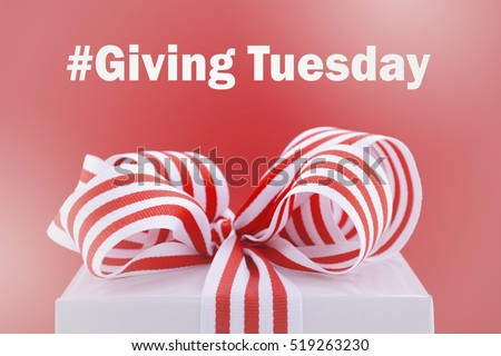 Red and white gift symbolic for Giving Tuesday with sample text on bright red and white background, with applied faded filters.  #519263230