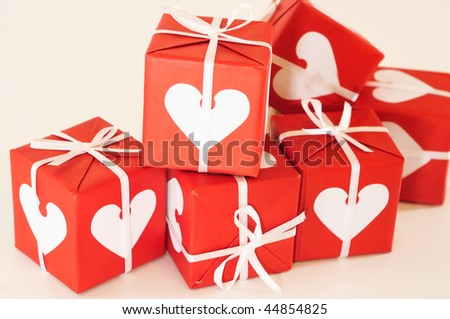 Red and white gift with white and pink ribbons