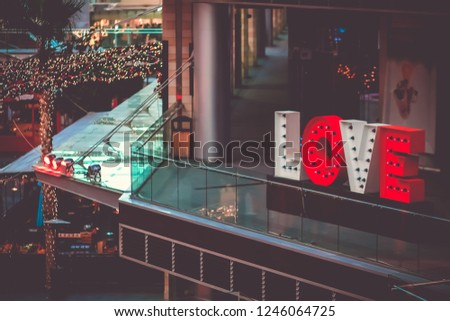 Red and white letters LOVE sign Neon led tube  located on public walking at Boulevard Amman, Jordan . LOVE background