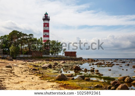 Red and white lighthouse, Russia . Photographed during the day in cloudy weather #1025892361