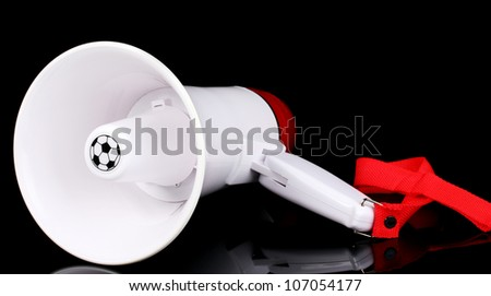 red and white megaphone isolated on black