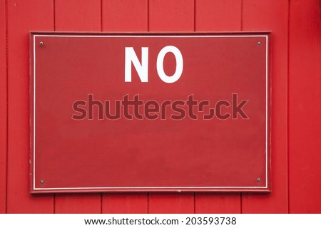 Red and White No Sign on Garage Door with Copy Space