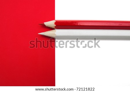 Red and white paper and pencils. Back to school theme