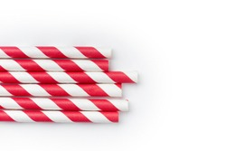Red and white party drinking straws on white background with copy space