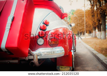 red and white retro cabriolet car closeup view, outdoors photo, stop signal lamp