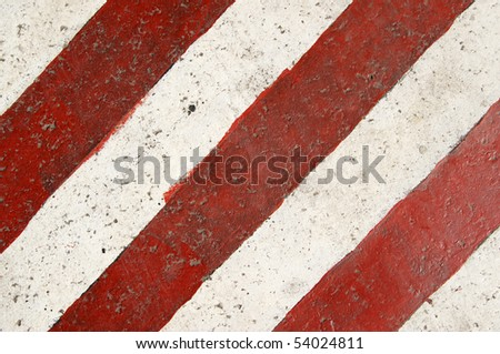 Red and white road marking