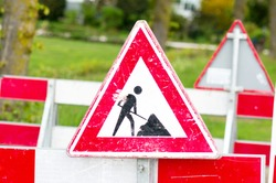 Red and white roadworks sign for construction works in street, Netherlands