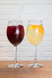 Red and white sangria in wineglass