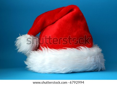 Red and white santa hat shot on a blue background