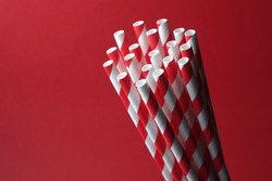 Red and White spiral patten  paper straws isolated on red background