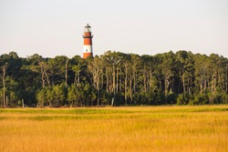 Red and White striped lighthouse beacon situated on Assategue Island Maryland