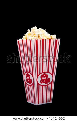 Red and white striped popcorn container on a black background