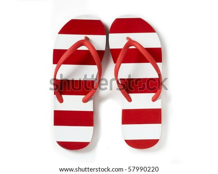 red and white stripy flip flops cut out on a white background - stock photo