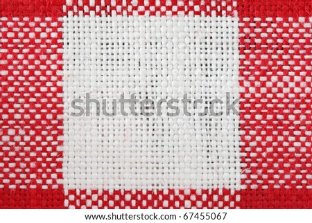red and white tablecloth macro with a single white square and the surrounding red areas