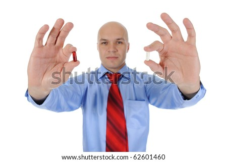 Red and white tablets in the hands of a businessman. Isolated on white background