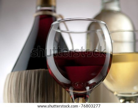 Red and white wine in elegant setting - stock photo