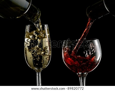 Red and white wine pour in two glasses