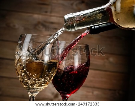 Red and white wine pouring