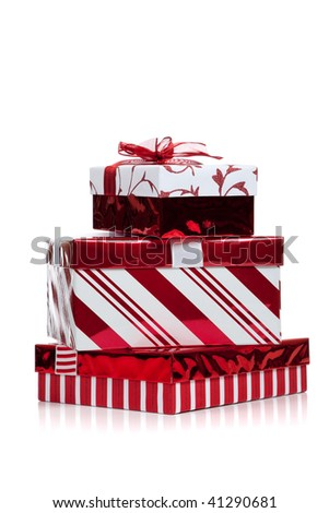 Red and white wrapped Christmas present on a white background with copy space