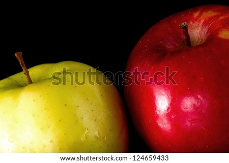 Red and Yellow  Apple on a black background