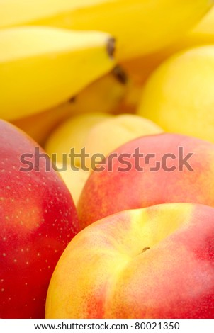 red and yellow background of fresh fruits