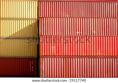 Red and yellow cargo container in a harbor
