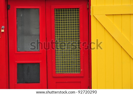 Red and yellow doors in a fish processing workshop in Maine