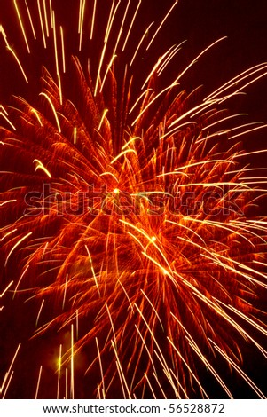 Red and yellow fireworks closeup on dark night sky background
