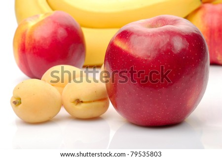 red and yellow fresh fruits isolated on white - stock photo