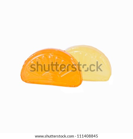 red and yellow fruit  candies on white background