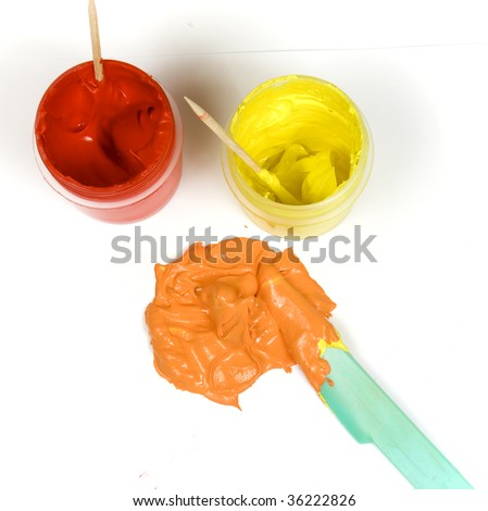 Red and yellow jars of paint mixed to make orange stock for How to make yellow paint