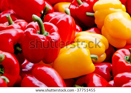 Red and yellow peppers at the market
