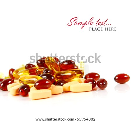 red and yellow pills on white background (shallow DOF)