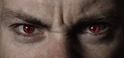 Red angry devil eyes closeup