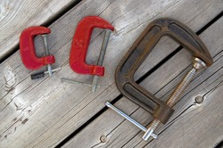 Red Antique Iron C Clamps on Weathered Wood Horizontal