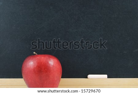 Red apple and chalkboard with chalk