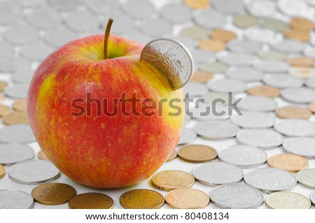Red apple and chinese coins