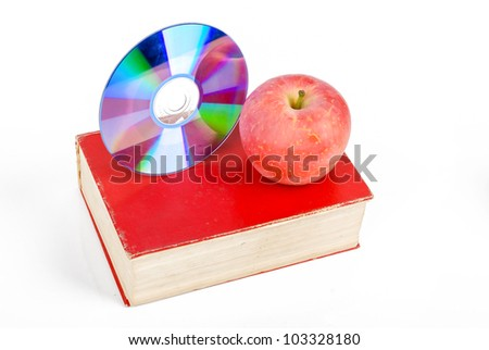 Red apple and DVD with book