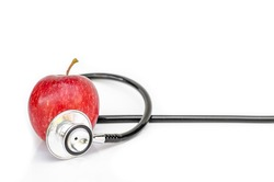 Red apple and Medical stethoscope isolated on white background