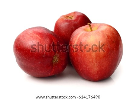 Red apple and slice on a white background.
