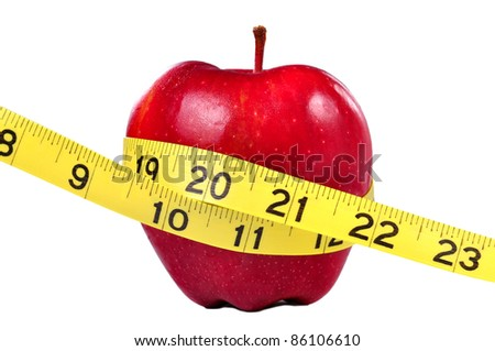 Red apple and yellow measuring tape to symbolize an healthy diet and body weight control.