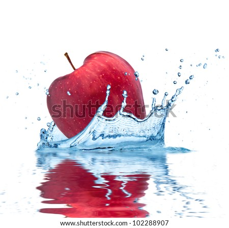 Red apple falling into water, isolated on white background