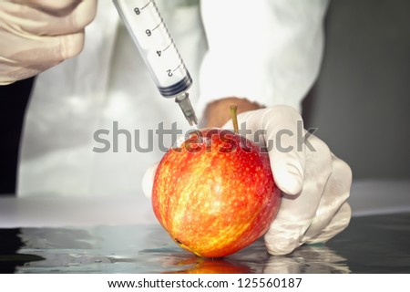 Red apple in genetic engineering laboratory, gmo food concept.