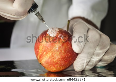 Red apple in genetic engineering laboratory, gmo food concept #684425371