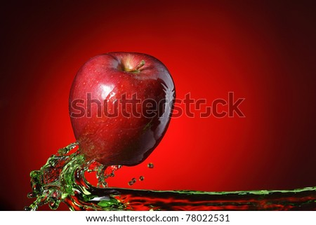 red apple in juice stream