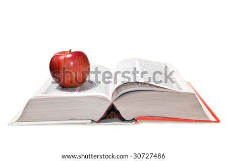 Red apple on a book. Isolated. Copy space for your text